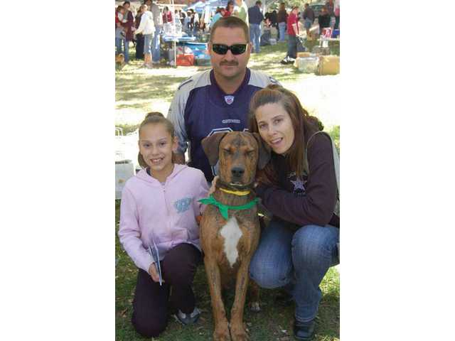 A family poses with their new canine addition from the fair in 2008.