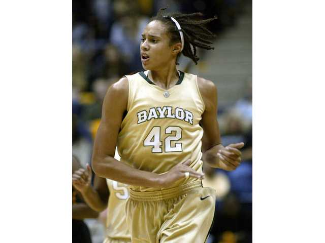 In this Nov. 22, 2009, file photo, Baylor's Brittney Griner runs back on offense and claps her hands after blocking a California shot during the second half of an NCAA college basketball game in Berkeley, Calif. Officials ejected Griner after the freshman punched Texas Tech's Jordan Barncastle in No. 14 Baylor's 69-60 win over the Lady Raiders on Wednesday night, March 3, 2010 in Lubbock, Texas.