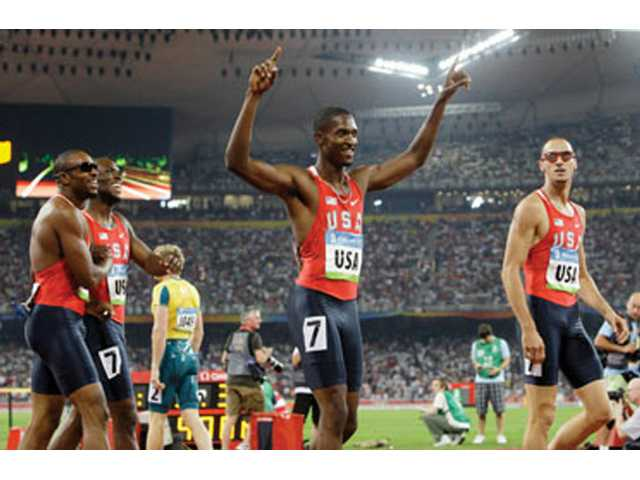 United States' 4x400-meter relay team members David Neville, front, and from left, Angelo Taylor, LaShawn Merritt and Jeremy Wariner, celebrate winning the gold medal Saturday, during the athletics competitions in the National Stadium at the Beijing 2008 Olympics.