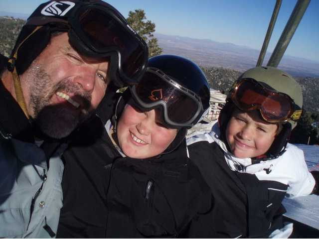 A self-portrait of an actual miracle, left to right, Eric Christiansen, Peter Christiansen and Will Christiansen prepare to hit the slopes.