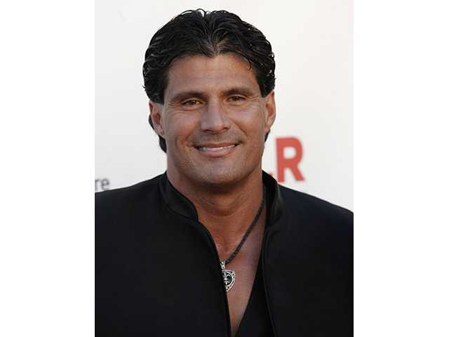 "FILE - In this Sept. 17, 2009 photo, Jose Canseco arrives at the ALMA Awards in Los Angeles. Canseco announced Tuesday, March 23, 2020, on Twitter that he had been subpoenaed by a grand jury investigating whether Roger Clemens lied to Congress when he denied using performance-enhancing drugs. Canseco posted on the social networking site that the FBI was about to visit his house, then said he had received a subpoena to appear before the grand jury ""about roger clemens,andrew pettite and others"" on April 8."