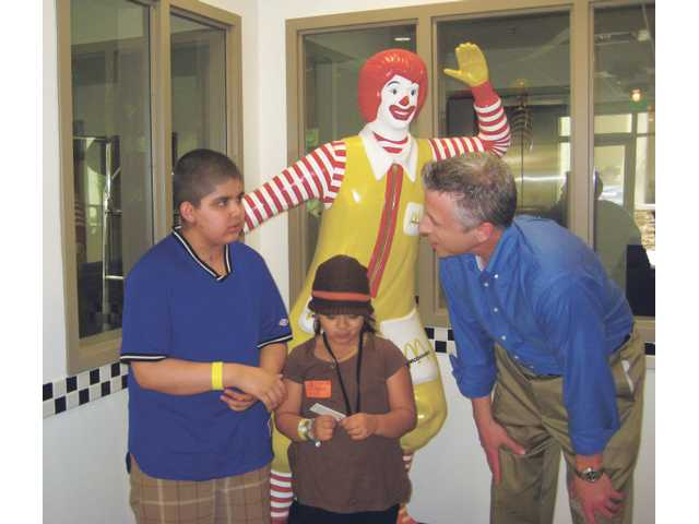 Chris Nehls, of Canyon Country, interacts with brother and sister Edgar and Elizabeth Perez, guests at the Los Angeles Ronald McDonald House.