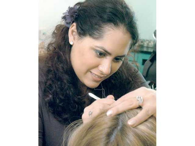 Michele Martinez, makeup and brow artist, works on a client at Senna Studios in Valencia.