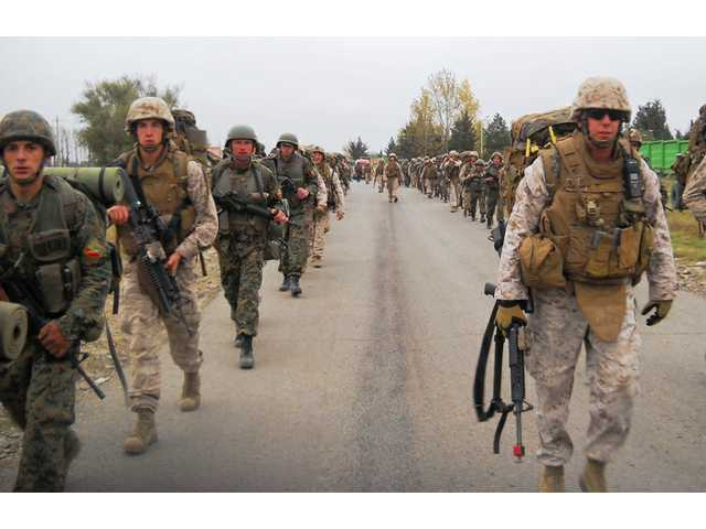 U.S. Marines and Georgian army soldiers participate in a road march during Immediate Response 10, a joint military training exercise held in Tbilisi, Georgia, in November 2009 involving U.S. and Georgian armed forces.