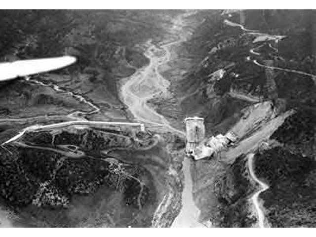 AFTER: On March 12, 1928, the St. Francis Dam broke, killing at least 450 people. The center portion of the dam remained standing, as shown in this photo, taken a day after the disaster.