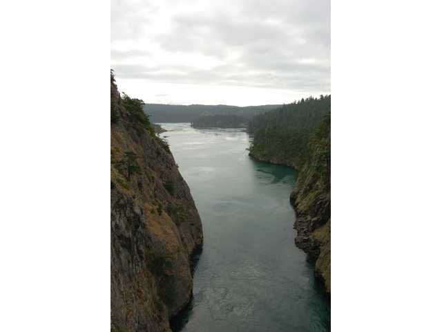 A view of Deception Pass in Washington, taken from a  bridge that overlooks the area.
