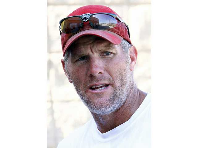 "This is a July 15, 2009, file photo showing former NFL quarterback Brett Favre talking to the media in Hattiesburg, Miss. Appearing on NBC's ""The Tonight Show"" on Thursday night, March 4, 2010, the Minnesota Vikings quarterback politely demurred when host Jay Leno asked for his thoughts on returning for 2010."