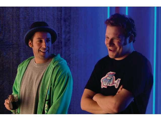 "Adam Sandler, left, and Seth Rogen are shown in a scene from Universal Pictures' ""Funny People."""