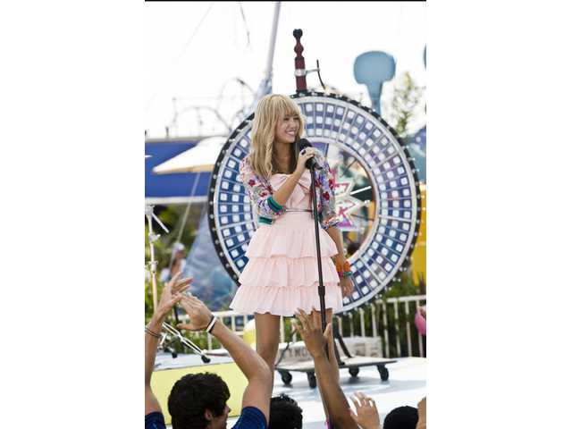 "Miley Cyrus in ""Hannah Montana: The Movie."" The film is based on the popular Disney Channel TV show."