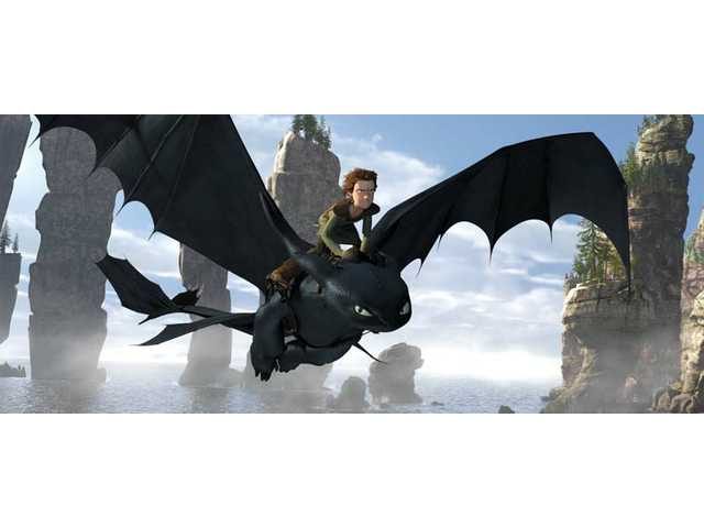 "Hiccup, voiced by Jay Baruchel, rides Toothless in a scene from ""How to Train Your Dragon."" The Paramount animated film opens in the SCV this weekend."