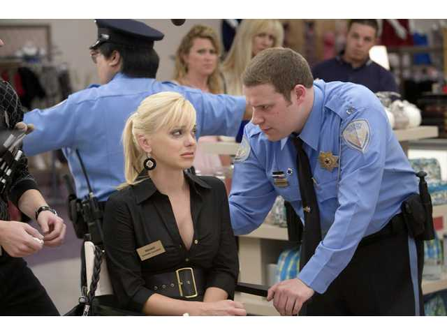 "Anna Faris, left, and Seth Rogen star in ""Observe and Report,"" a comedy set in a shopping mall."