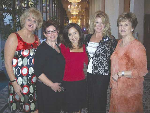 Guild President Cathy Montoya, left, Fashion Show co-chairwoman Tamra Levine, Guild Corresponding Secretary Carol Neyer, Guild members Karen Krosskove and Terrie Cipriano.