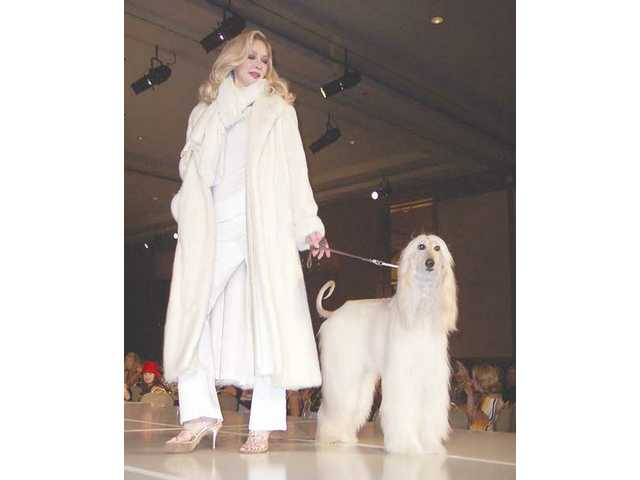 A model dressed in white has a matching canine companion.