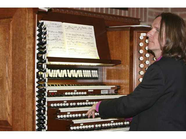 "Noted organist Christoph Bull, pictured at the pipe organ at UCLA's Royce Hall in June, guests at this weekend's Bach festival, performing ""Bach to the Future!: An Organ/Fusion Laser Light Show"" Friday night at 9."