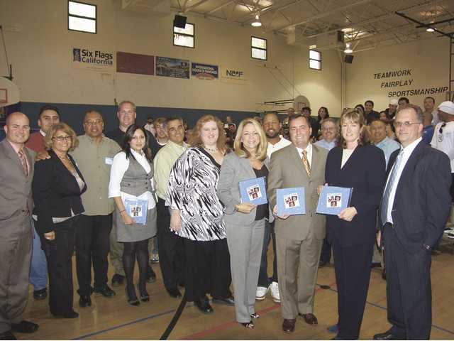 The Boys & Girls Clubs honored Jay Thomas, second from right, the president of Six Flags Magic Mountain, and others during a recognition meeting held at the SCV Boys & Girls Club Newhall facility.