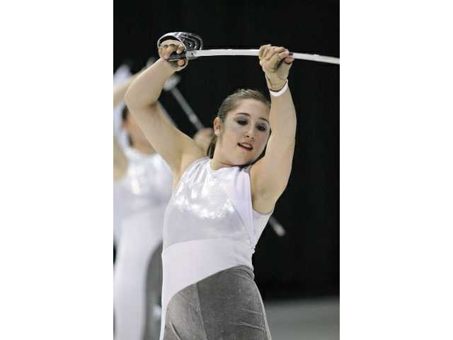 Katie Fundora, a member of the Valencia Color Guard team, practices for the Winter Guard International World Championship this April.