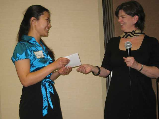 USC  sophomore  Jenny Jao receives a check for $1,000 from Committee Chair Cindy Kittle as winner of the Jane M. Klausman Women in Business scholarship. She will represent the SCV Zonta Club in District 9 competition, which could lead to a $5,000 scholarship.