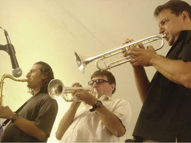 Elliot Prichard, 19, middle, performs with the Tom Nolan Orchestra's saxophonist, Victor Cisneros, and trumpet player, Evan Avery, during LARC Ranch's 50th Anniversary celebration. Prichard, a Canyon Country resident, has austism.