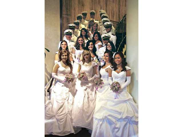 The Henry Mayo Newhall Memorial Hospital Silver Rose Guild 2009-2010 debutantes pose with University of California Los Angeles midshipmen at the Grand Ball held on March 13 at the Sheraton Universal.