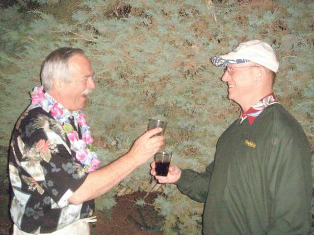 President-elect Mike Thomas, left, and Bart Aikman toast at the SCV Rotary Club's fundraiser.