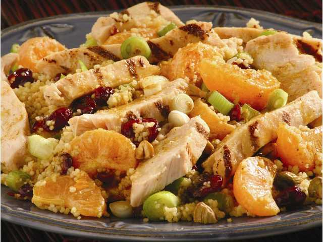 Mandarin Chicken Couscous Salad With Curry VinaigretteServes 41 10-ounce package plain couscous3 fresh mandarins, peeled and separated into segments1/2 cup dried cranberries1/4 cup pistachios, coarsely chopped1 bunch green onions, sliced, including some green top (about 1/2 cup total), dividedCurry Vinaigrette, divided (recipe below)12 ounces frozen grilled chicken strips, heated according to package directions Prepare couscous according to package directions, remove to large bowl. Stir mandarin segments, cranberries, nuts and half green onion into couscous; add half of vinaigrette and toss well. Arrange on large serving platter; top with chicken. Drizzle evenly with remaining vinaigrette and garnish with remaining green onion. Serve immediately.Curry Vinaigrette: In small bowl whisk together 1/4 cup mandarin juice or white wine vinegar, 1 teaspoon curry powder, 1/4 teaspoon ground cinnamon, 1/2 teaspoon salt, 1/8 teaspoon cayenne, 1 teaspoon honey and 1/3 cup canola or other vegetable oil.