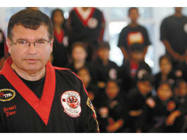 Martial arts instructor David Moreno, who teaches youth at the Newhall Community Center, does more than teach students how to break boards and kick opponents. After his son, Joshua died in a tragic accident last year, Moreno began teaching his class - in addition to a course he was already instructing.