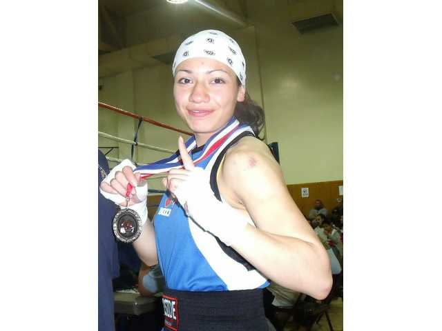 Mayte Razo took home the 2009 Southern California District Golden Gloves title in the girls' 125 pound novice weight division.