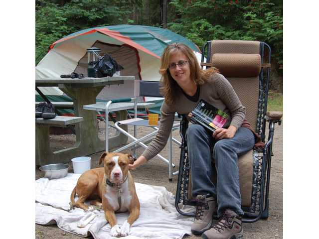 Sathe and Loren take it easy at their camping site in Deception Pass, where the duo met Sathe's parents, their dogs, and friends. Besides eating, reading is Sathe's favorite vacation pastime.