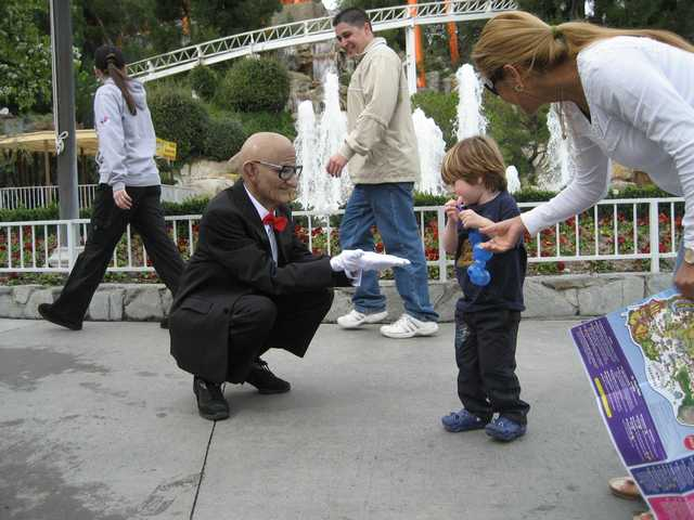 "Mr. Six, the ""More Flags, More Fun"" character used in the marketing campaign for Six Flags Magic Mountain in Valencia, is shown greeting guests at the theme park during his ""premiere"" appearance."