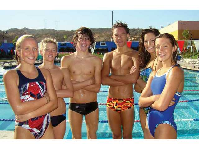 Six Canyons Aquatic Club swimmers who will compete in an international meet stand at their morning practice Saturday at the Santa Clarita Aquatic Center. Left to right: Bryana Waage, Matt Johnson, Riley Mita, Nui Harris, Sarah Pino and Megan Schultz.