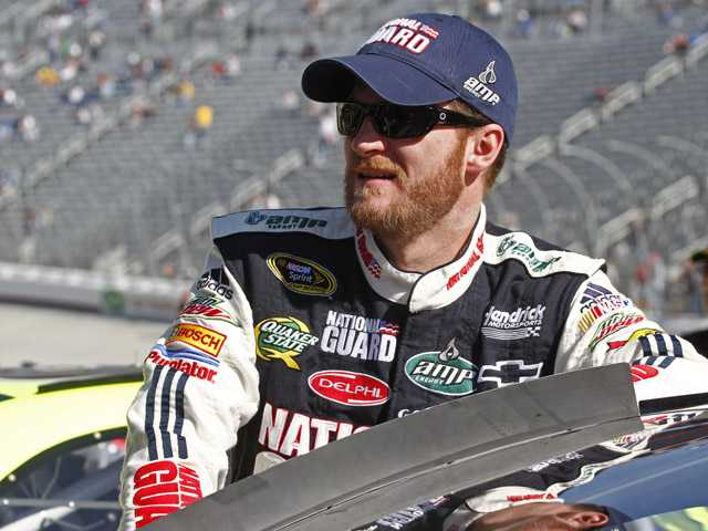 Driver Dale Earnhardt, Jr., waits by his car before practice for Sunday's NASCAR Nationwide series Scotts Turf Builder 300 auto race at Bristol Motor Speedway in Bristol, Tenn., Saturday, March 20, 2010.