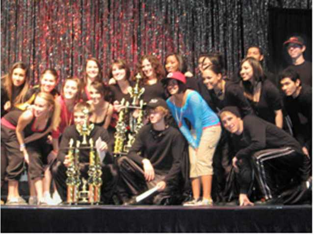 New World Dance teams collect trophy and $1,000 cash for each of the winning routines.