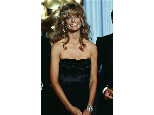 In this April 14, 1980 file photo, actress Farrah Fawcett-Majors is shown at Academy Awards Presentations in Los Angeles.