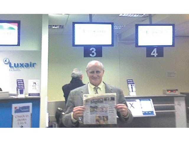 Canyon Country resident Bill Wolf stops in London City Airport before a flight to Brussels in this picture taken March 2.