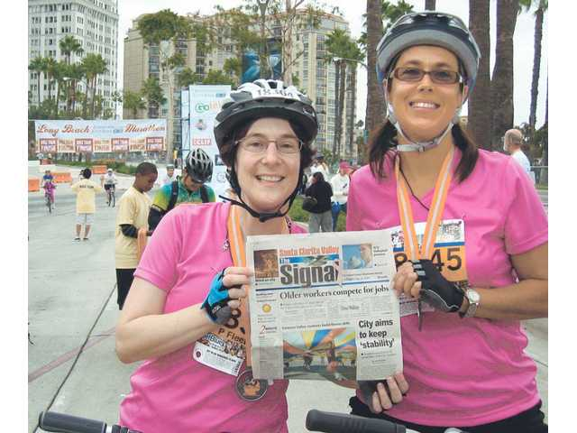 Patti Fleetwood, left, and Jennifer Ketterling, both of Valencia, had this photo taken after completing the cycling race at the Long Beach Marathon in October.
