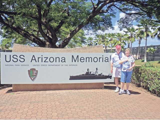 In a photo taken by friends, Harry and Georgene Christensen pose in front of the USS Arizona Memorial in Pearl Harbor, Honolulu, Hawaii, in September.