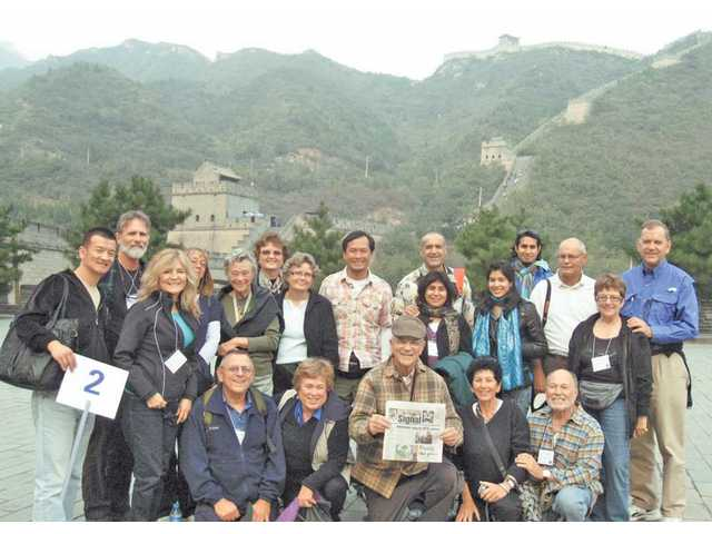 A group from the Santa Clarita Valley Chamber China trip poses with The Signal in front of the Great Wall of China. The members of the group are (in no particular order): John Yang, Azam Awan, Seher Awan, Mohammed and Fakhriya Awan, Gene Harman, Janet Ferguson, Carolyn Turk, Beverly Crneckiy, Ruth Thresher, Lynne and Richard Dressen, Arla and Jay Crane, Howard and Sharon Brody, Richard and Sonia North and Frank Marion.