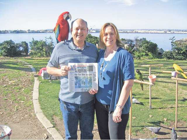 Gene and Donna Lee Giddings pose with parrots Rosie and Lucy after visiting Seaport Village in San Diego to celebrate Donna's birthday. The picture was taken March 2.