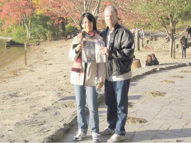 Husband and wife Diane McMann and John Gillott pose at Walden Pond in October.