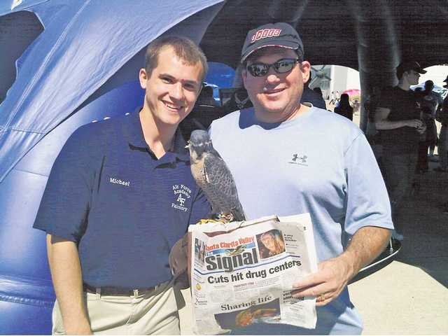 Michael O'Kelley, left, of Santa Clarita, and his uncle Jeff Solomon at the Miramar Air Show in San Diego on Oct. 3. O'Kelley is in his second year at the Air Force Academy in Colorado Springs, Col. Solomon is holding Oblio, a Peregrine Falcon, who makes special appearances at events as the academy's mascot.