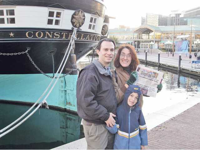 Jason and Leah Pollack pose with son Max at Baltimore's Inner Harbor on Nov. 6.