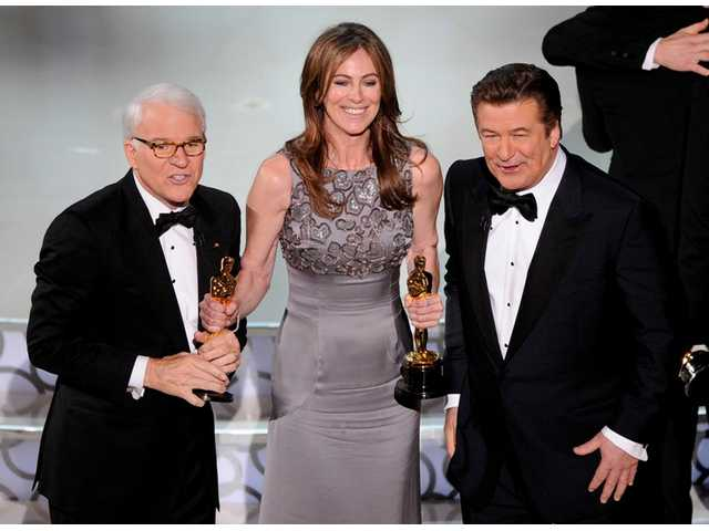 "Kathryn Bigelow, center, holds her Oscars for best motion picture of the year and best achievement in directing for ""The Hurt Locker"" with hosts Alec Baldwin, right, and Steve Martin at the conclusion of the 82nd Academy Awards Sunday, March 7, 2010, in the Hollywood section of Los Angeles."