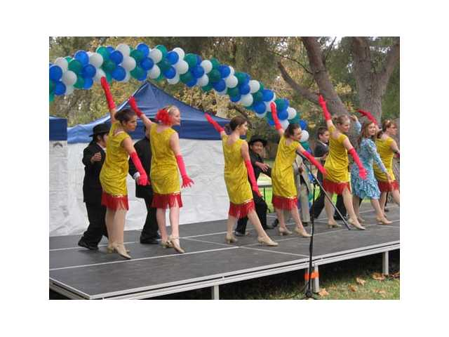 "Members of the Drama Club at Placerita Junior High filled the main stage of the SCV Literacy & Arts Festival with songs and dance from their upcoming production of ""Thoroughly Modern Millie."""