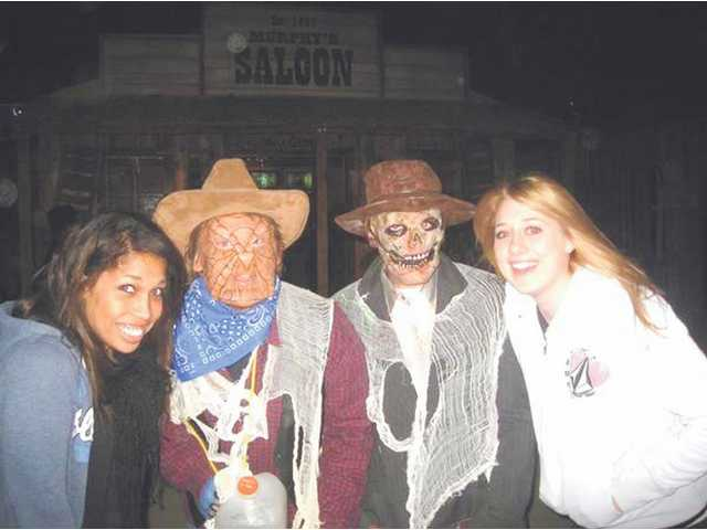 "Guests to the annual Heritage Haunt and Pumpkin Festival at the SCV Historical Society in Newhall enjoy the company of a pair of ""ghouls."" Volunteers are invited to work on this year's Heritage Haunt. A variety of volunteer opportunities are available, including construction and as Haunt characters."