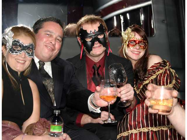 Melissa Pillow, Robert Pallasch, Mikee Schwinn and Amber Van Loon toast the New Year inside a Mercedes van limousine provided by Driven2Drive Limousine Service.