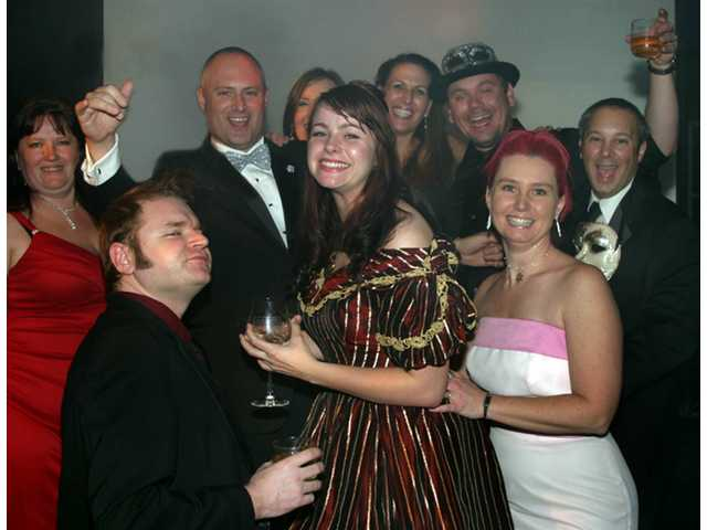 Revelers at the REP Carnivale di Venezia include from left, Dawn Abasta, Jason Price, Amber Van Loon, Angela Illich-Owston, Ovington Michael Owston, Angela Price and George Cummings.