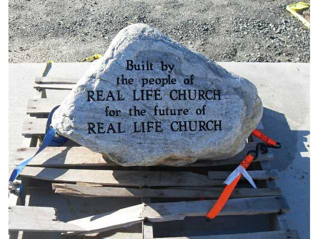 "The church's cornerstone, which reads ""Built by the people of REAL LIFE CHURCH for the future of REAL LIFE CHURCH."""