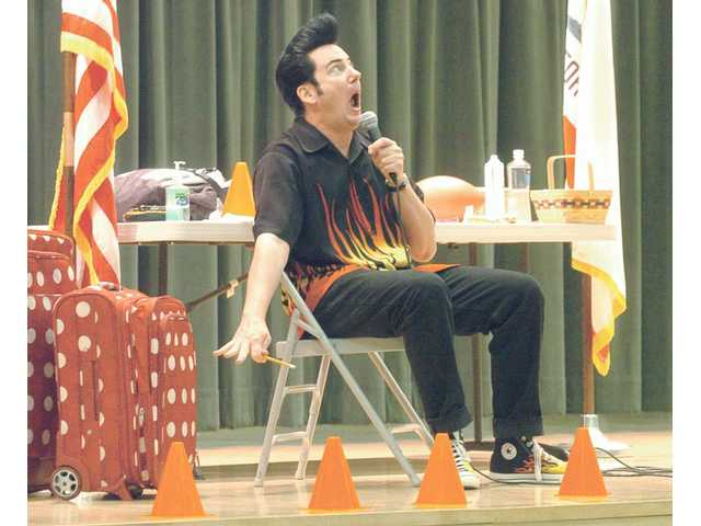 "Bill Russ, as ""Retro Bill,"" presents serious life lessons in a humorous way at Pico Canyon Elementary School on Tuesday."