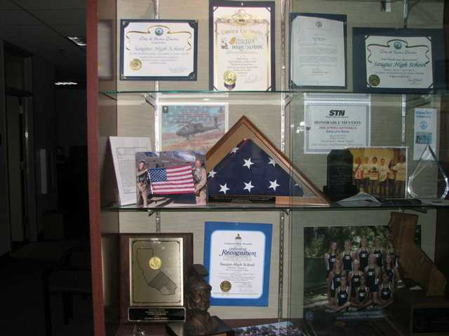 The American flag in the display case in the front lobby of Saugus High School is heading back into duty.