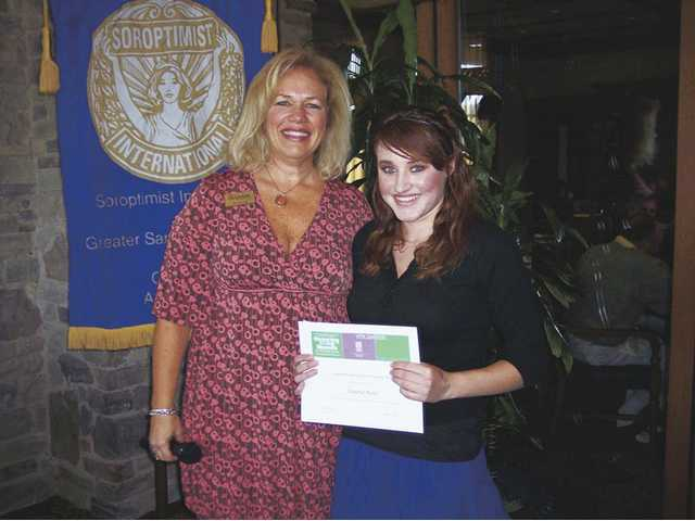 Kris Hough, left, of Soroptimist International of Greater Santa Clarita Valley presents the Violet Richardson Award to Canyon High School student Shaina Katz.